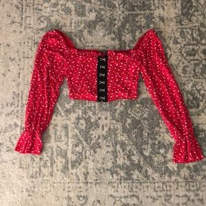 Red, black, and white flower crop top